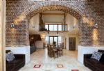 Ground floor:  Original 15' high brick arch