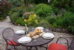 Al fresco dining overlooking the delightful garden
