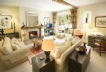 Ground floor: Open plan sitting room with open fire, dining and kitchen