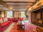 Ground floor: Large sitting room with wood burning stove