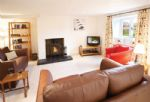 Ground floor: Sitting room with wood burning stove