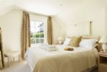 First floor: Double bedroom with 5' bed and en-suite shower room and wc