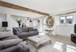 Ground floor: French doors open out from the sitting room to the garden
