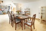 Ground floor: The open plan dining area has a large dining table seat six