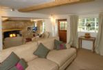 Ground floor:  Cosy sitting room with inglenook fireplace, bread oven and wood burning stove