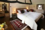 First floor:  Bedroom three with 6' super-king size bed, exposed beams and an attractive cruck shaped ceiling