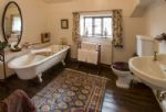 First floor:  Bathroom with claw-foot cast iron bath and hand-held shower attachment
