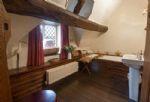 Second floor: Bathroom with wood panelled bath