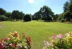 Set within two acres of lush gardens