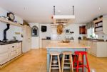 Ground floor: The fully fitted kitchen includes a four oven Aga
