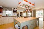 Ground floor:  Kitchen looking through to conservatory