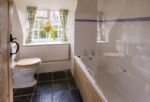 First floor:  Bathroom with electric shower over bath and wc