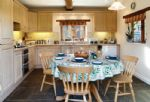 Ground floor: Kitchen with dining table and french doors to garden