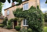 Old School Cottage with accommodation for four guests is a small, detached stone property in the unspoilt Windrush Valley, a few miles from Burford