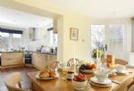 Ground floor: Dining area with kitchen beyond
