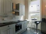 Kitchen - oven, hob, bar table/stools