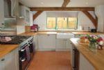 Hiron's Piece Ground floor:  Kitchen with range cooker and Belfast sink