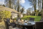French doors open from the kitchen onto a raised terrace, perfect for al fresco dining