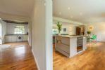 Ground floor: Hallway and kitchen with island