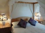 On the first floor - a sumptuous double bedroom with 4-poster ..