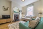 Ground floor: Sitting room with coal effect fire
