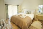 Ground floor: Double bedroom with 6' super-king size bed