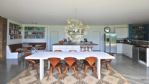 The Curved House Kitchen and Dining Area - StayCotswold