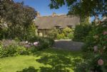The mature and well stocked gardens provide a country living backdrop