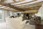 Ground floor: Sitting room with overhead beams and a large inglenook fireplace with open fire