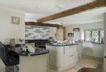 Ground floor:  Kitchen with Rangemaster cooker,  an island and breakfast bar