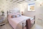 Ground floor: L shaped double bedroom with 5' bed and 3' single bed with adjoining wet room