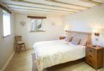 Ground floor: Master bedroom with 5' bed with en-suite bathroom