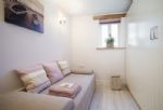 Ground floor: Further double L shaped bedroom with 5' bed and 3' single bed with dressing area and family shower room