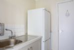 The well equipped utility room has a washing machine and tumble dryer, plus separate toilet.