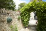 Enter the enclosed garden via this beautiful Wisteria archway