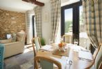 Ground floor:  Sitting/dining room with french doors leading to the garden