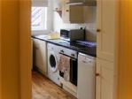 ...including a dishwasher, electric oven, hob and extractor, microwave, washer and fridge freezer.
