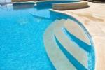 Roman Steps into Pool