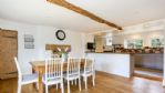 Upton Downs Farmhouse Dining Area - StayCotswold