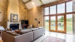 Marsh Farm Barn Lounge Area and Fire Place - StayCotswold