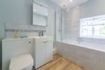 First floor: The family bathroom with a bath with shower over, wash basin and WC