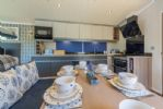 The open plan dining/kitchen area is sociable and easy to work in
