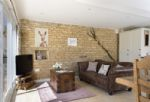 Ground floor:  Exposed stone wall in sitting area