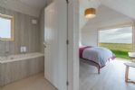 Ground floor: King-size bedroom with sea views and en-suite facilities