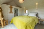 Ground floor: Super-king zip and link bed with sea views and en-suite shower room
