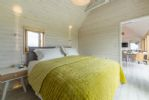 The Watch Room Super King zip and link bed, sea views, en-suite bathroom containing shower.