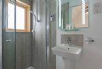 Contemporary en suite shower room to the twin bedroom.