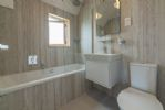 Spacious and contemporary bathroom to the master bedroom.