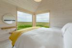 The Listening Station: King-size bedroom with sea views and en-suite bathroom containing bath and overhead shower