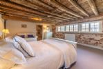 Second floor: Master bedroom has its original beams and brickwork